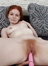 Florence in red is smoking hot, but things get even hotter when she gets down to her birthday suit. This red haired nympho has on just pumps when she violates her hairy pussy with her pink vibrator!