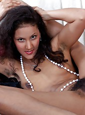 Ocean Sky looks classy in nothing but a furry white vest and black skirt and beautiful pearls, but she looks even better when she strips down to nothing but the pearls and her hairy pussy.