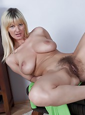 Blonde bombshell Vanessa J has two very ripe melons and one very hairy mound. When she takes off her lime green mini to show them off your mouth will water at the site of this hairy gal!