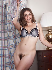 Tasty Tanya is home from her friends wedding. All that matrimonial bliss got her a little hot and bothered, so she strips down and gives her hairy pussy a little post ceremonial celebratory action.