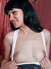 Yana is wearing a dress with a big face on it and she teases you as she slowly takes it off. She spreads her legs on the couch and pulls on her hairy pussy before she finally takes off her dress.