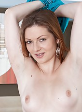 Beautiful hairy girl Bula is home from a night at the club and she is ready to relieve a little bit of tension. She rubs herself down, taking off her blue dress and rubbing her hairy pussy.