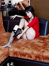 Lanka is a dark haired woman in a little red dress and black pantyhose. in the living room she starts to strip. Once naked she spread her hairy pussy lips apart to show off her moist pussy.