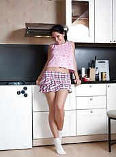 Indy is a sexy brunette in the kitchen when things start to get hot. She takes off her clothes one piece at a time, taking her time to tease before showing her hairy pussy. She sits on the counter and spreads her legs wide apart to show each intimate deta