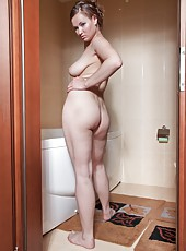 Chrysty is a sultry brunette with large natural breasts and a nice hairy bush.  She loves it when men watch her wash her body, especially when she decides to spread her hair pussy for them.