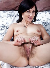Kristy is a sexy and very hairy girl who enjoys teasing all of her adoring fans by showing off her hairy pussy.  I think it