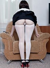 Candy S is reading a magazine and then decides she wants to take off her glasses because she is going to strip. Leaving only her white stockings on she spreads her legs and plays with her hairy pussy!
