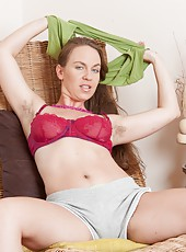 When Erin Eden wants to relax she like to sit in her lounge chair. She has on green panties covering her hairy pussy. So she needs to take them off Spread her legs and play with her hairy pussy!