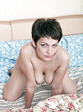 Karina just walked into her bedroom and is ready to enjoy some alone time with her hairy pussy! She takes her time undressing and then breaks out two toys to put deep inside her pussy!