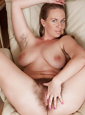 Erin Eden is one hairy woman. She likes to get naked and expose her hairy armpits and hairy pussy! Sitting in her chair with her legs spread in the air she shows spreads open her pussy with her hands.