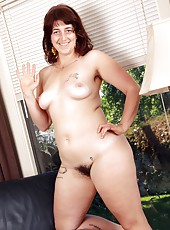 Natural Gwyneth runs her hands over her chubby soft body down to her pink juicy bush.