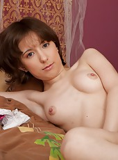 All natural Miki opens her slender legs on the bed and shows off her wonderful puffy pussy lips.