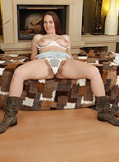 All natural Erin Eden shows off her curvy sexy body and full fluffy dark haired pussy in front of the fire place!