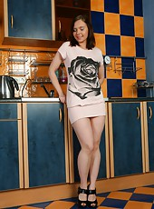 With a dress so short you can see all the way to the holy land. Sexy Effasa gets up to no good in the kitchen and shows off her gorgeous bush.