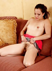 As she lays back on the sofa, Lani Pink places her hands at the bottom of her ass and pulls her furry lips nice and wide for everyone to see.