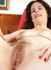 Mature Marie loves to suck her feet and spread her moist pink hairy pussy wide. See her slowly strip out of her dress, lean back on the chair separate her creamy thighs.