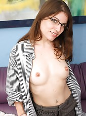 Enough study, Holly cant stop thinking about pulling her panties to the side and rubbing her hairy clit and pussy. Her glasses might fog up!