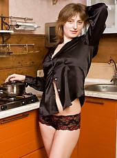 Wearing only a silky shirt and sexy panties Kate L begins to cook, but finds herself arching her back, and pointing her perfect hairy ass to the heavens.