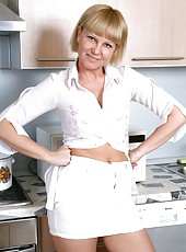 Things really heat up as mature Lana stops cooking and flaunts her big hairy snatch around the kitchen. She has a bush so juicy, you can almost taste it!