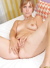 Soft, pink and hairy are only a few words to describe April and her tightly packed natural body and bush. Don