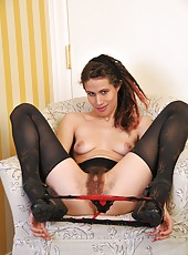 Unrivaled hair fiend Kitty Bush feels so sexy in her little leopard top and see through panties. Watch her spread her legs wide and enter her extremely hairy pussy