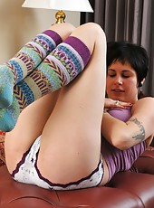 Luna relaxes with some stretching and quick core workout before ripping off her clothes, revealing her big natural tits and black pussy and ass hair