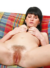 Mila loves the feeling of a soft blanket of on her hairy pussy...it makes her feel so horny.