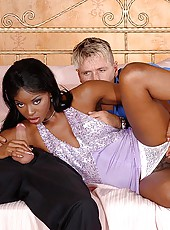 Sexy ebony taking two hard cocks