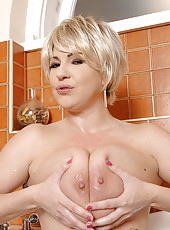 Busty Babe Sucks Cock In The Tub