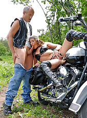 Vivien L sucking cock on motorbike