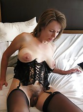 Compilation of a sexy naughty housewife spreading on the bed