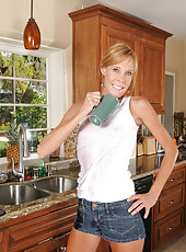 Blonde housewife Stacey Y sprays down her pussy at the kitchen sink