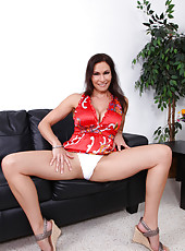 Sexy mature nude woman pops out her huge Anilos tits on the couch