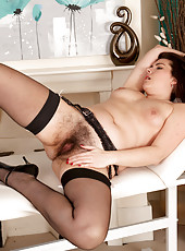 Long haired Sharlyn plays naughty nurse and treats her hairy pussy