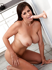 Milf enjoys her suction cup toy cock in the kitchen