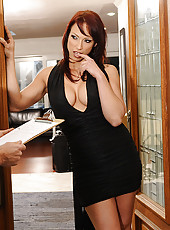 Busty redhead cougar invites guy into so she can seduce him into fucking her.