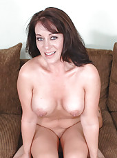 Sandy Beach rides big cock on the couch.