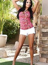 These hot photos of Anissa Kate will warm you right up. She looks so pretty in her sexy summer outfit.