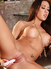 Capri Cavanni looks stunning as she strips off her clothes and inserts a toy inside her wet pussy.