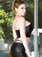 The sexy Kagney Linn Karter spreads her legs and shows off her shaved little pussy.
