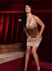 Jelena Jensen strips out of her gold dress exposing her natural tits and beautiful body.