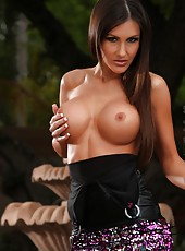 Busty brunette, Evelin Rain, gets sexually excited fairly easy, especially if a camera is involved because it means fans will be looking at her. Such a turn on!
