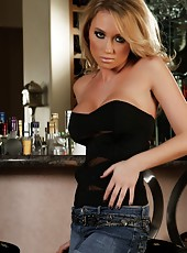 Busty blonde babe, Madison Scott, strips out of her sexy black top and denim mini skirt revealing her big boobs and smoking hot body.