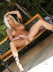 Gorgeous busty babe, Eden Adams, strips on a park bench. This sexy blonde has so much fun getting naked for you, showing off her big tits and amazing assets.