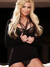 Stunning busty blonde, Phoenix Marie, is smoking hot in her little black dress, black lingerie, and sexy black thigh high boots!  She looks even hotter in nothing but those boots and pearls!