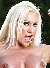 Rocking her big, hard body Ashlee Chambers strips off her clothes as she flexes and poses.