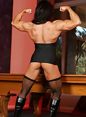 The dominating Angela Salvagno stands in her thigh highs and boots, she strips and flexes her big strong body.