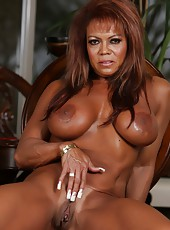 If you love muscles, hard asses, tan lines, big breasts and a big clit, DD is your fantasy girl.