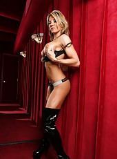 Fit Abby Marie models her sexy bling bra and panties as she strips naked except her big black boots.