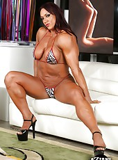 Amber Deluca shows off her big strong hot muscles as she strips out of her bikini.